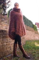 Mohair poncho with huge rollneck.